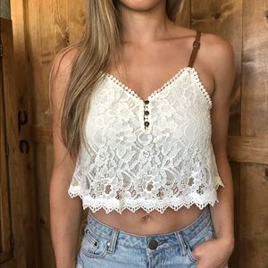 Lace crop top w/leather strap detail